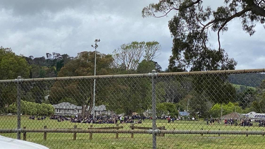 Students from Bowral High School were evacuated to the nearby oval following a threatening email. Classes have resumed as normal. Photo: supplied.