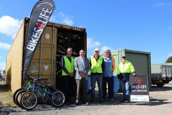 Bikes 4 Life volunteers Colin Faulkner, Hans Rodowitz and Jeff Appleton with Wingecarribee Shire Mayor Duncan Gair and Steve Glendenning from Resource Recovery Australia. Photo: supplied.