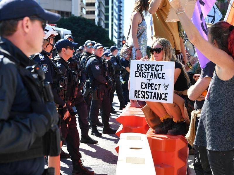 Queensland climate protesters have denied claims of booby-trapping traffic-stopping devices.