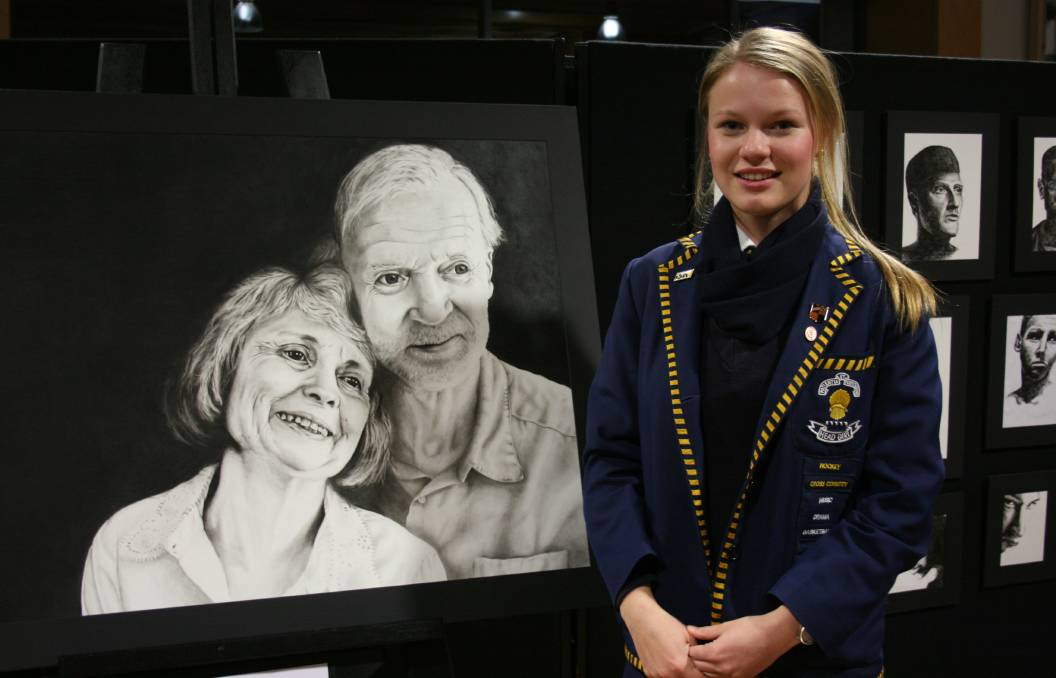 Zoe Binder with her charcoal portait. Photo supplied