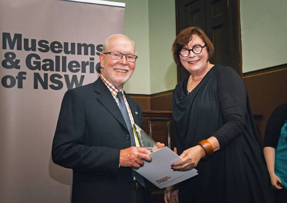 Harlan Hall, volunteer Berrima District Museum, accepting winning Imagine Awards for New museum gallery extension and for Cloud Stories from Jennifer Barrett, chair of M&G NSW Board, Museums and Galleries of NSW Imagine Awards 2015. Photo supplied